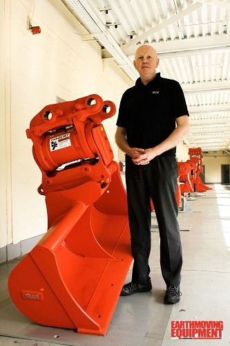 Steve Ferguson Miller, Engineering Manager, alongside the new fully cast PowerLatch Tilt quick Coupler.