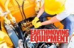 Asian motor mechanic working on construction or mining machinery
